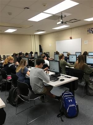 Students working at computers in a computer lab